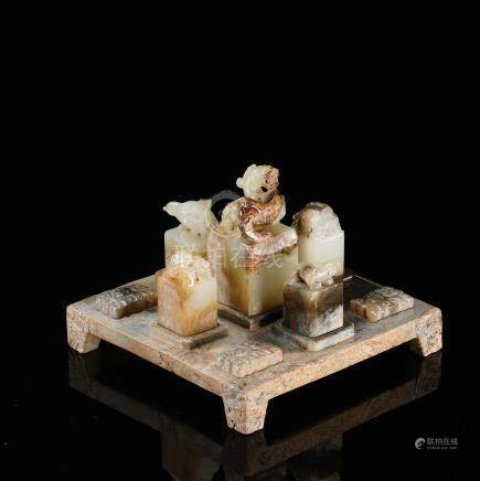 FIVE CHINESE ANCIENT JADE BEAST SEALS ON STAND