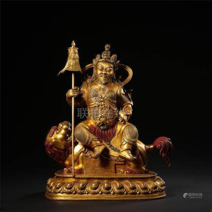 CHINESE GILT BRONZE SEATED GOD OF WEALTH ON LION