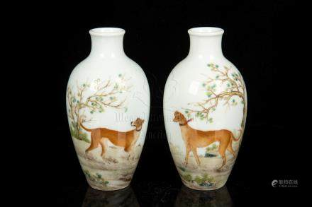 PAIR OF FAMILLE ROSE 'DOGS' BOTTLE VASE