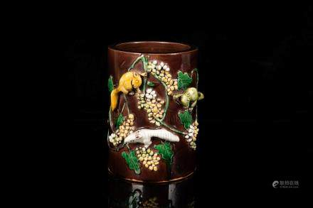 SANCAI GLAZED AND CARVED 'SQUIRRELS' BRUSH POT