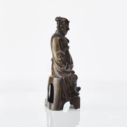 A bronze figure of a seated Daoist deity