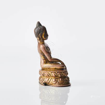 A Tibetan gilt copper alloy figure of Buddha Akshobhya