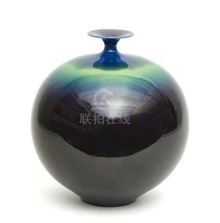 Grand vase globulaire (tsubo) évasé et a petit col. La glaçure hekimei varie du