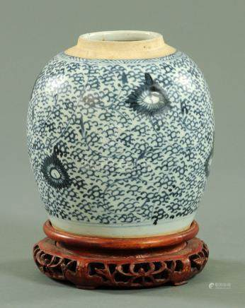 A Chinese blue and white ginger jar, 19th century, decorated with stylised lotus scroll decoration,