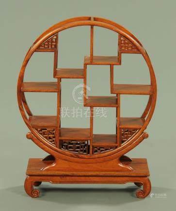 A Chinese hardwood moon shape vase stand, 20th century,