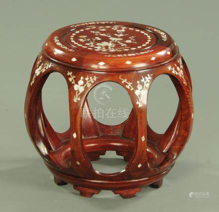 A Chinese hardwood and mother of pearl inlaid drum form vase stand,