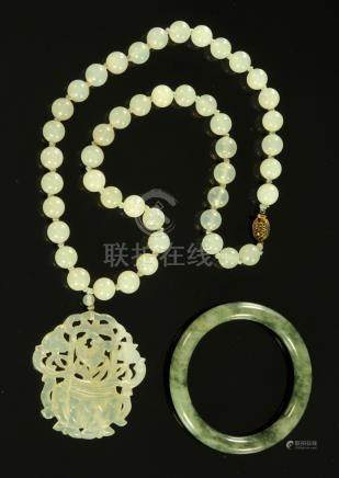 A Chinese jade pendant on beaded necklace, 20th century, with silver gilt clasp,