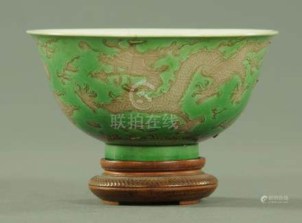 A Chinese green and aubergine dragon bowl, six character Kangxi mark within two blue circles,