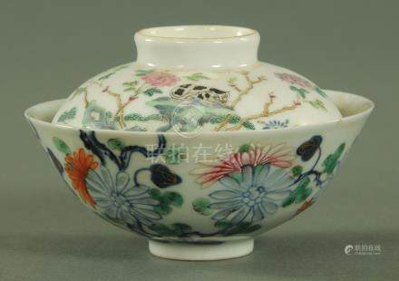 A Chinese Wucai bowl, 18th/19th century, decorated throughout with carnations and peony,