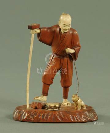 A Japanese carved wood and ivory Sarumawashi, Meiji period,