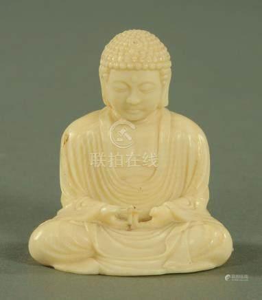 A simulated ivory figure of the Amida Buddha, early 20th century, 7 cm high.