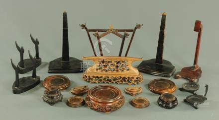 A collection of Oriental carved hardwood stands, for plates and vases,
