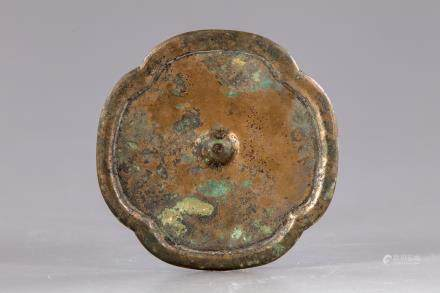 A Chinese four-lobed bronze mirror