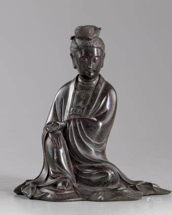 A Chinese bronze figure of Guanyin
