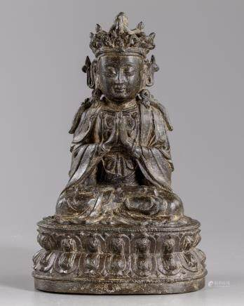 A Chinese bronze figure of a Guanyin