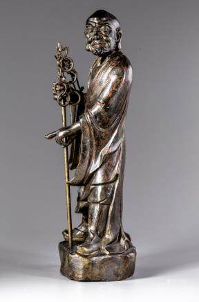 A gilt Chinese bronze figure of a Luohan