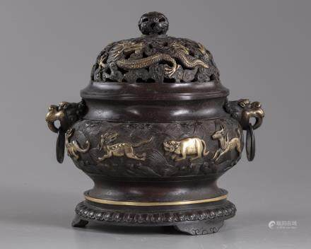 A Chinese parcel-gilt bronze 'sea creatures' censer, cover, and stand