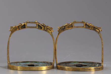 Two Chinese gilt bronze and cloisonné stirrups