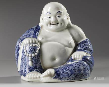 A Chinese blue and white figure of Budai