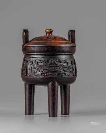A Chinese hardwood archaistic tripod censer and cover