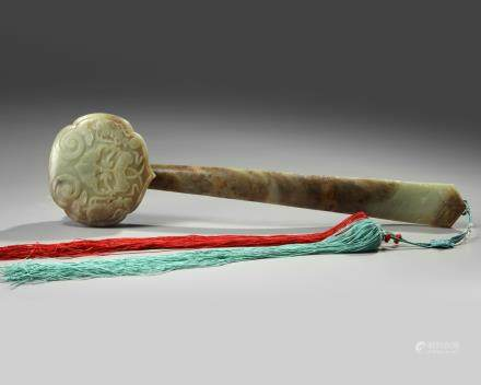 A large Chinese celadon and russet jade ruyi-sceptre