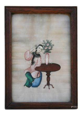 A 19th century Chinese watercolour on pith paper depicting a young woman seated by a table. 17 by