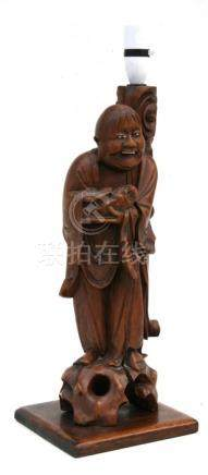 A Chinese rootwood figural table lamp depicting a robed man with his toad familiar. 42cm 916.5