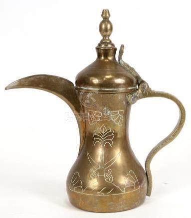 A Turkish / Islamic brass dallah coffee pot, 278cms (10.5ins) high.