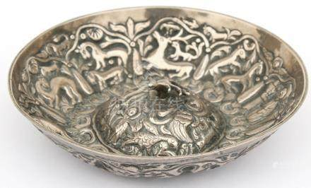 An Eastern white metal bowl decorated in relief with figures and animals. 13.5cm (5.25 ins) diameter