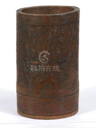 A Chinese carved bamboo brush pot decorated with birds amongst foliage, 18cms (7ins) high.