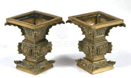A pair of 19th century Chinese bronze vases, 10cms (4ins) high.