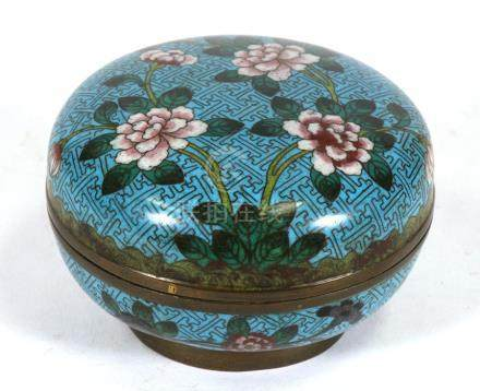 A Chinese cloisonne box & cover decorated with flowers on a turquoise ground, 12cms (4.75ins)