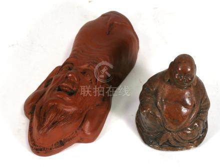 A stoneware Buddha, 9cms (3.5ins) high; together with a Yixing pottery style wall pocket; 18cms (