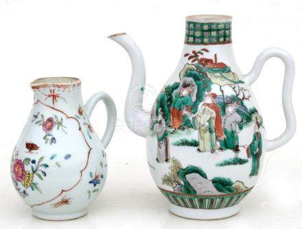 A 19th century Chinese famille verte wine jug decorated with figures, 16cm (6.25ins) high;