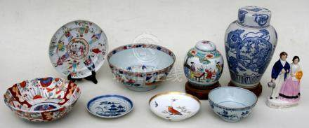 A group of Chinese and Japanese ceramics to include a Chinese famille rose plate decorated with