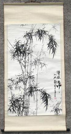 A Chinese scroll painting depicting bamboo and calligraphy, 63 by 121cm (25 by 47.5ins); together