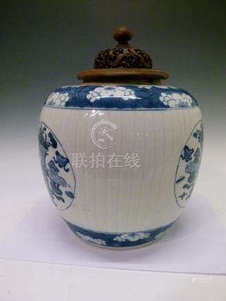 Chinese porcelain ovoid jar, having blue and white painted reserves decorated with antiques and
