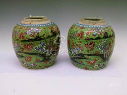 Pair of Chinese ginger jars, each having 'clobbered' decoration depicting butterflies and foliage