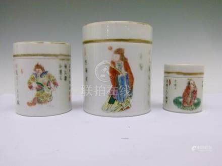 Set of five Chinese Famille Rose cylindrical containers and covers, each decorated with figures