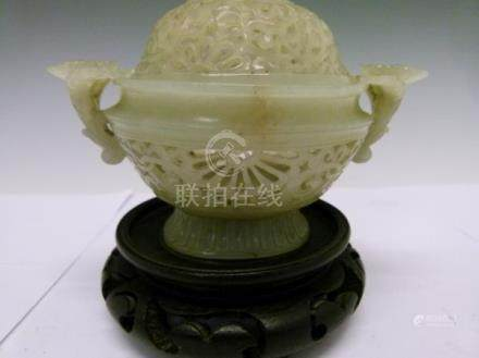 Chinese jade censer, 18th/19th Century having pierced decoration, flowerhead handles and standing on