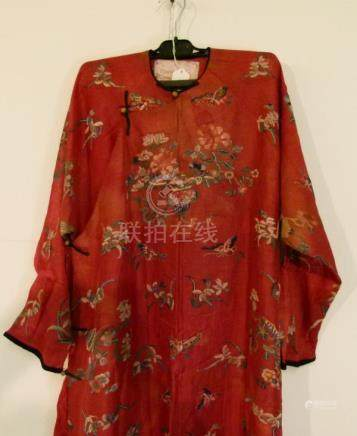 19th Century Chinese woven silk robe, decorated with butterflies, flowers and other objects on a red