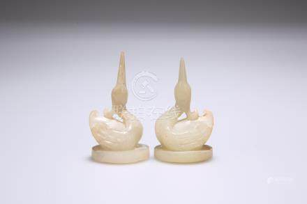 A PAIR OF CHINESE CARVED HARDSTONE MODELS OF CRANES