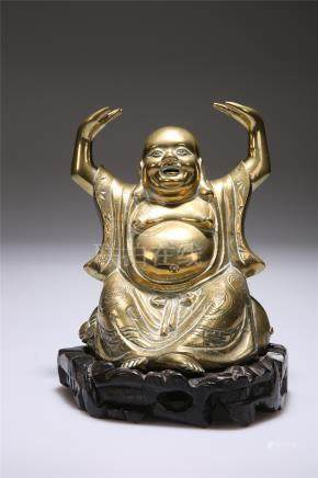 A CHINESE BRASS FIGURE OF A SEATED BUDDHA