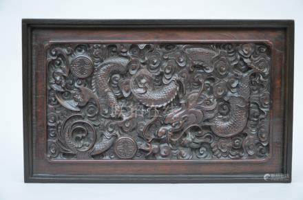A Chinese panel in hardwood 'dragons'