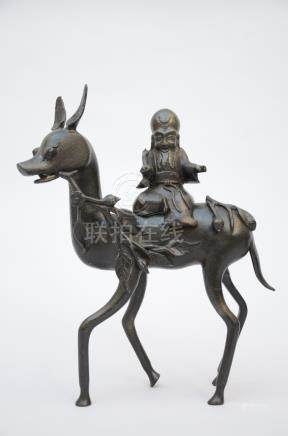 A Chinese bronze statue 'Laotsé on a deer' (*)