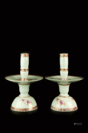 A PAIR OF EXPORT FAMILLE ROSE CANDLE HOLDER