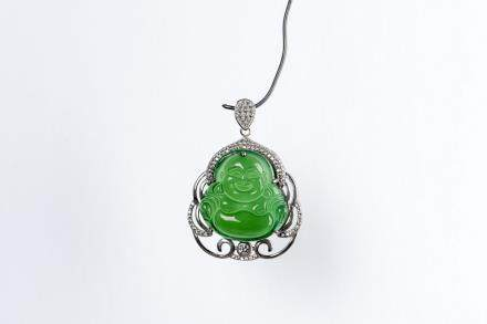 A BUDDHA JADEITE AND DIAMOND PENDANT