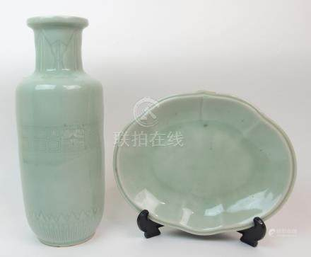 A CHINESE CELADON VASE incised with a stiff leaf band to the neck above a taotie mask and key