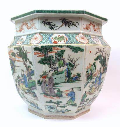 A CHINESE OCTAGONAL FAMILLE VERTE JARDINIERE painted with panels of figures in various settings
