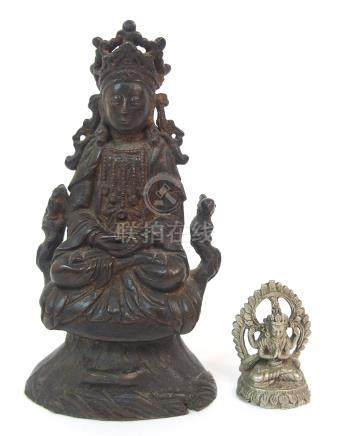 A CHINESE BRONZE MODEL OF BUDDHA seated with tiered crown and on a raised throne, 15cm high and a